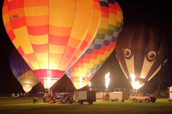 A night glow or balloon glow at fairs or organized balloon events around the country